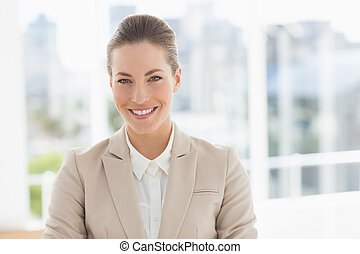 Close-up portrait of a young businesswoman smiling
