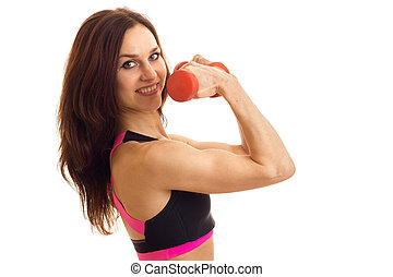 close-up portrait of a young strong sports Brunettes with Dumbells above in hand