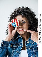 girl with american flag cupcake