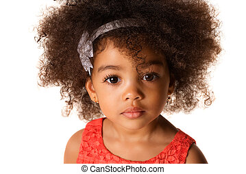 Close up portrait of african-american little girl, in studio isolated