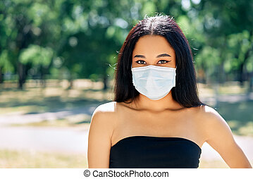 Close up portrait of african american woman in virus protection face mask
