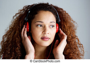 african american woman listening to music with headphones