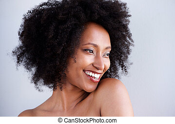 Close up portrait of african woman with naked shoulders smiling