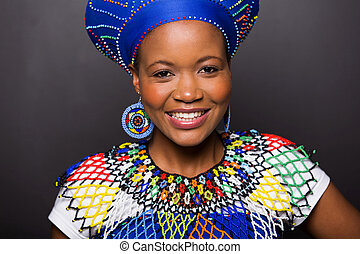 african zulu girl wearing traditional attire - close up...