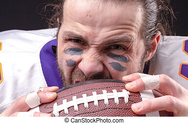 Close up portrait of aggressive American Football Player