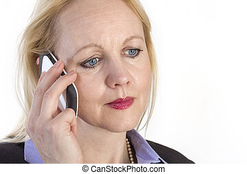 Close-up portrait of an adult beautiful business woman speaking on a phone.