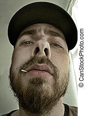 Close-up portrait of an arrogant man