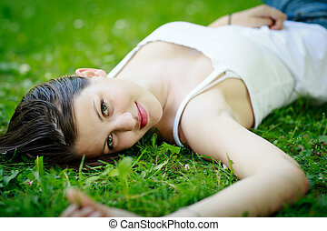 Close-up portrait of an attractive young woman outdoors