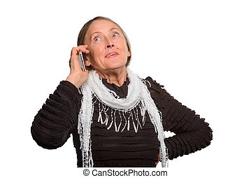 Close-up portrait of an elder woman. Granny gossips on a mobile phone