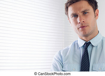 Close up portrait of an elegant young businessman in office