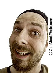 Close-up portrait of an exuberant man