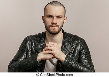 close up portrait of angry handsome strong man preparing his fists to fight