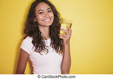 asian girl with beautiful smile and holding a glass of water