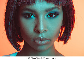 close up portrait of attractive african american girl looking at camera