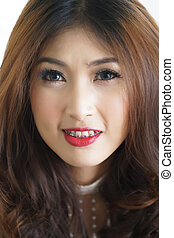 Close-up portrait of attractive beautiful Asian woman.