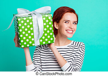 Close up portrait of attractive beautiful she her lady holding large giftbox in hands glad ready to unpack it wearing white striped sweater isolated on teal background