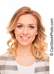Close up portrait of attractive cheerful young woman with curly hair