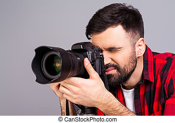 Close up portrait of attractive man shoting with camera
