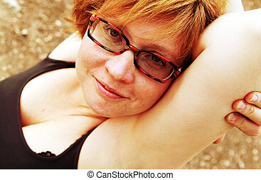 Close up portrait of attractive redheaded woman