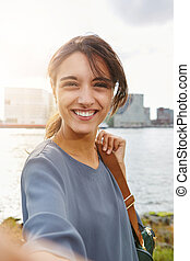 attractive young woman talking selfie and smiling