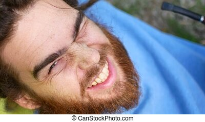 close up portrait of bearded man smiling cheerful optimistic...
