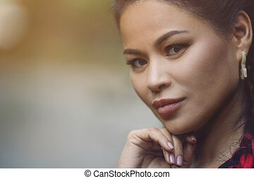 Close-Up Portrait of Beautiful Adult Asian Woman Outdoor