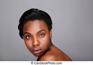 Close up portrait of beautiful black woman with bare shoulders