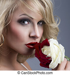 close-up portrait of beautiful blonde woman with red - white ros