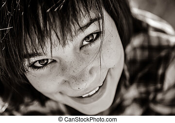 Close-up portrait of beautiful brunet girl.