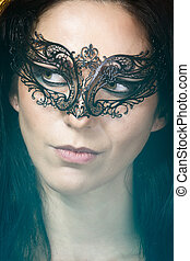 close-up portrait of beautiful brunette woman with carnival...