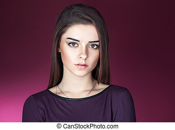 Close up portrait of beautiful brunette young woman