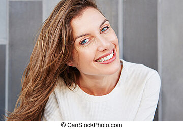 beautiful face of young smiling woman