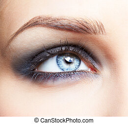 close-up portrait of beautiful girl's eye zone make up