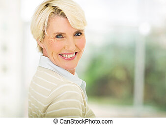 middle aged woman indoors - close up portrait of beautiful ...