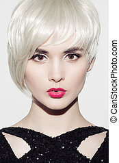 Close-up portrait of beautiful model with perfect glossy blond hair and bright make up. White background.