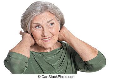 Close up portrait of beautiful senior woman on white background