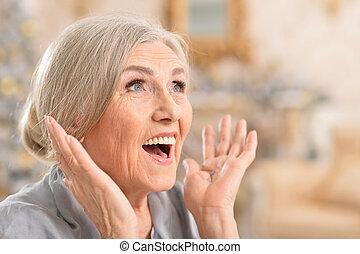 Close up portrait of beautiful senior woman smiling