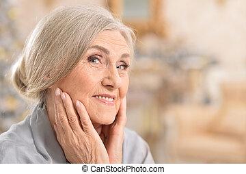 Close up portrait of beautiful senior woman