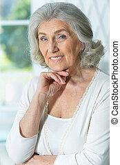 Close up portrait of beautiful smiling senior woman