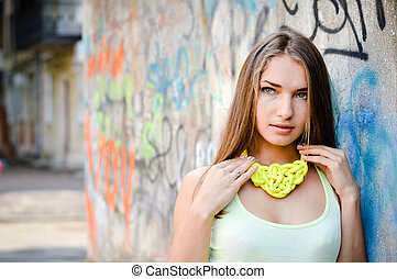 close up portrait of beautiful stylish fashion woman fair hair blond girl having fun gently smiling and looking at camera on graffiti wall city urban summer or spring outdoors copy space background