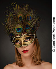 Close-up portrait of beautiful woman with carnival mask.