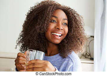 beautiful young african american woman drinking cup of tea