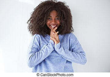beautiful young african woman smiling with hand on face
