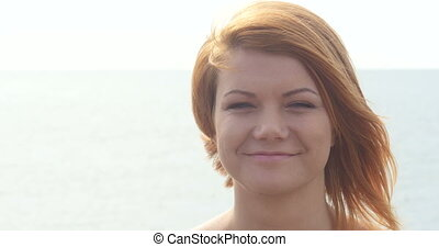 Close up portrait of beautiful young redhead woman