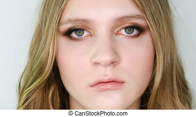 Close up portrait of beautiful young woman face with bright...