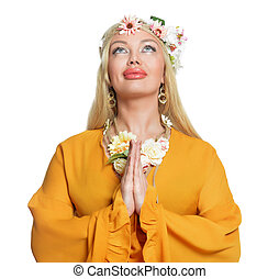 Close up portrait of beautiful young woman praying on white background