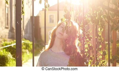 Close up portrait of beautiful young woman. wind blowing hair.
