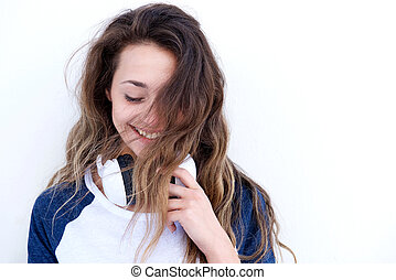 beautiful young woman with headphones laughing