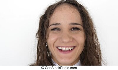 Close up portrait of beauty young woman with brown eyes, smiling looking at camera on a white background. slow motion.