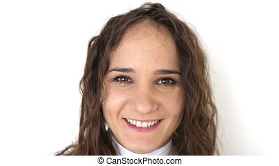 Close up portrait of beauty young woman with brown eyes, smiling looking at camera. slow motion.